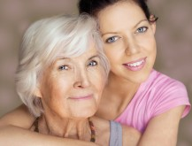 Caregiver & gray Haired woman